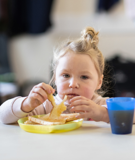 A child eating a meal at a table